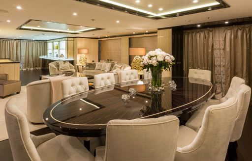 lacquered dining table with lounge beyond on board luxury yacht ELIXIR