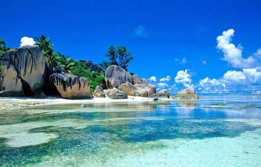 idyllic beach with white sand and crystal waters in South East Asia