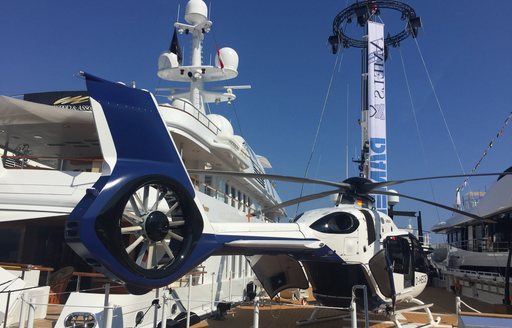 support vessel New Frontiers with helicopter on deck at the Monaco Yacht Show 2017