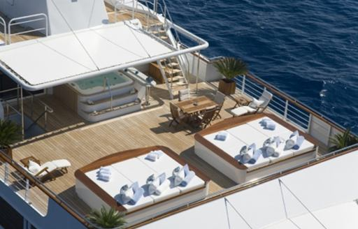expedition yacht TITAN's sun pads and deck jacuzzi