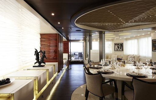 beautifully styled formal dining area aboard superyacht E&E