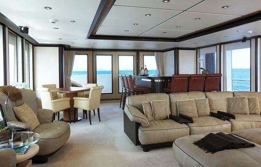 lounge and bar in main salon of superyacht HARLE