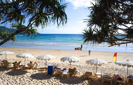 View of Kata Beach on Phuket, woth loungers and umbrellas looking towards the sea