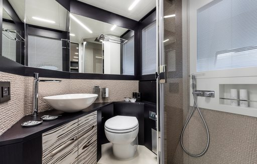 Sink, toilet and shower on motor yacht BEYOND, and mirrors behind