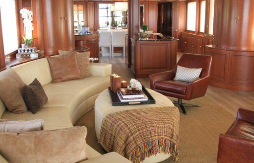 Main salon interiors of luxury charter yacht BRUNELLO