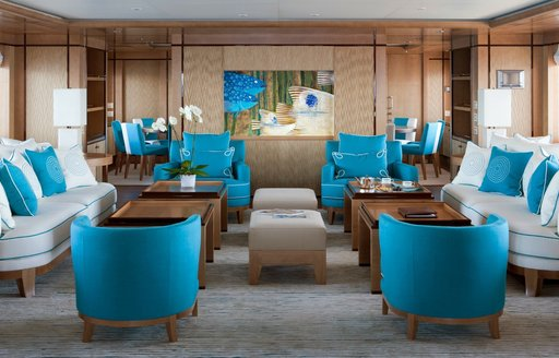 Blue and white furnishings inside the main salon of luxury yacht Ramble On Rose