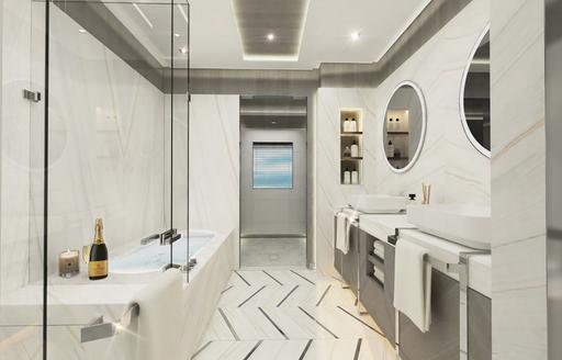 master suite bathroom with large tub and mirroring