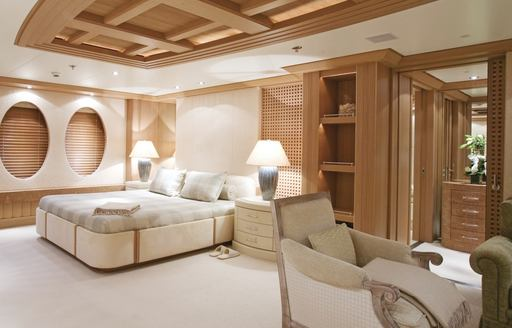 timeless master suite with oak panelling on board superyacht Deja Too