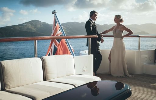 charter guests dress up for evening aboard charter yacht MEAMINA