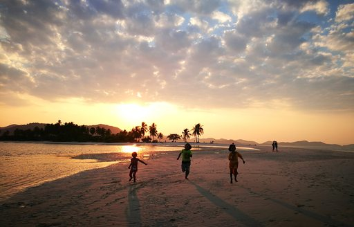 Kids playing on beach in Thailand
