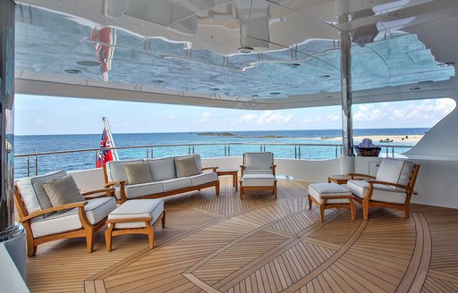 Aft deck with social seating and al fresco dining aboard superyacht REBEL