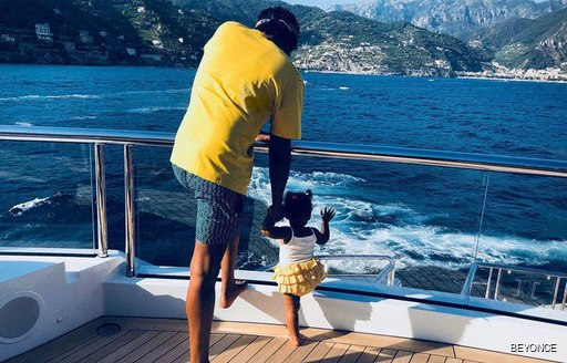 Rapper Jay-Z and his daughter Rumi on luxury yacht KISMET