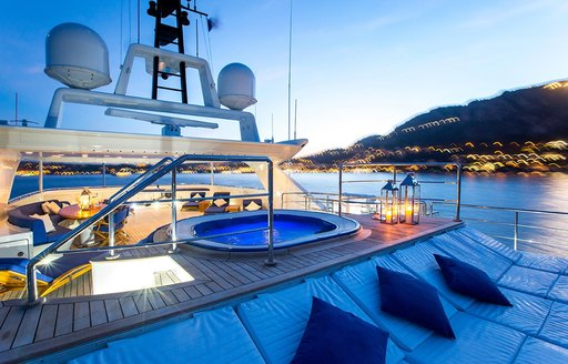jacuzzi and sun pads as sun sets on board luxury yacht MISCHIEF