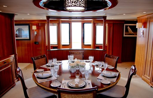 circular dining table in the dining salon aboard luxury yacht M4