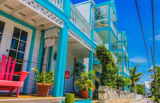 Colorful Caribbean Architecture, Caribbean house exterior with tropical plants and street. Elbow Cay, Hope Town, Abaco,