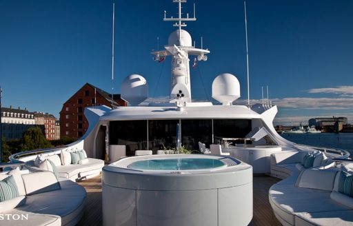 Jacuzzi surrounded by comfortable seating on sun deck of luxury yacht Odessa II