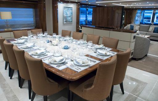 formal dining in the main salon of superyacht 'Princess AVK'