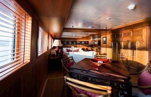 Elegant room with table and chairs on superyacht Bleu De Nimes