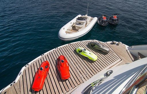 A collection of water toys gathered around the swim platform of superyacht PATHOS