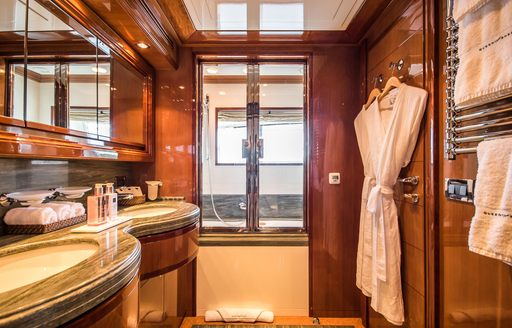 Ensuite on Superyacht Queen of Sheba with sink and dressing gown visible