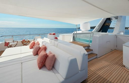 Jacuzzi and covered lounging area on charter yacht JOY