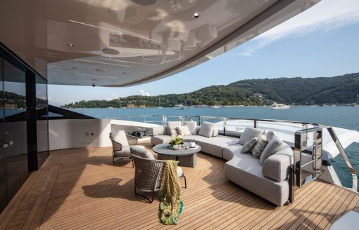 Aft deck seating on superyacht MA, with sea views in background
