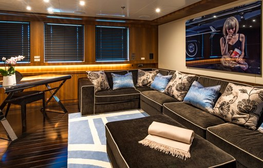 Comfortable seating area on art work in lounge of superyacht RARITY