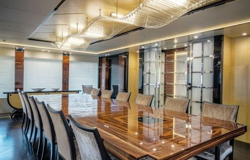 rosewood dining table under 7m chandelier aboard luxury yacht Party Girl