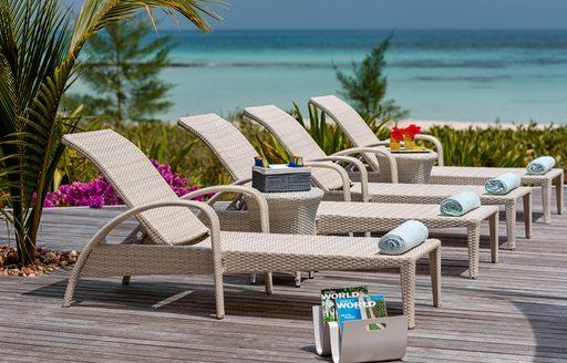 sun loungers next to pool on thanda island