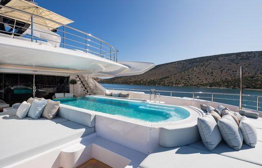Swimming platform on superyacht O'PARI surrounded by sunpads