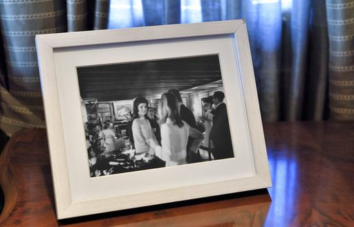 Black and photograph on stand of Jackie Kennedy on board iconic megayacht Christina O