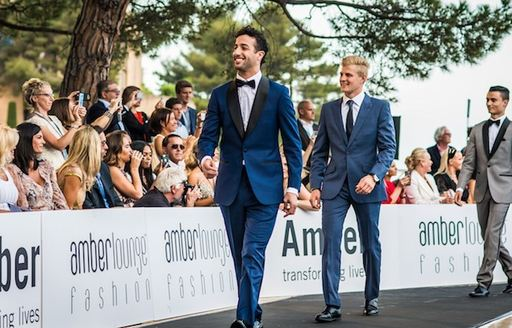 Drivers on catwalk at the Amber Lounge fashion show in Monaco