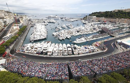 The section of the Monaco Grand Prix track with yachts lining it