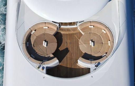 curved seating areas on foredeck of charter yacht CAPRI