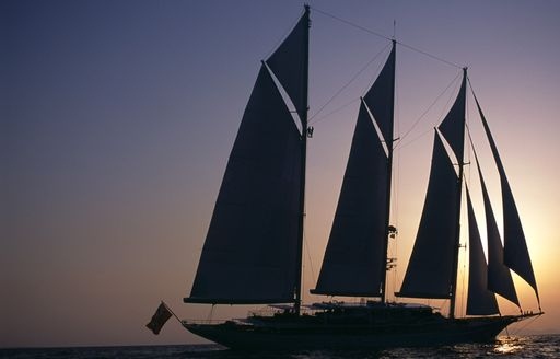 Sailing yacht ATHENA at sunset in the Mediterranean