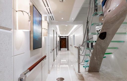 Glass staircase on megayacht EQUANIMITY