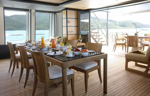 dinning in the bridge deck lounge on board motor yacht HARLE