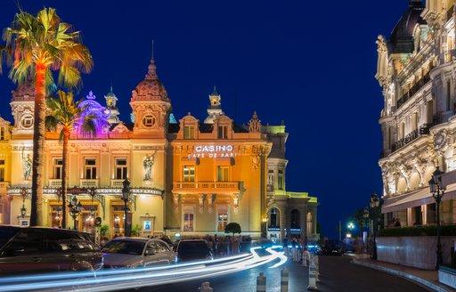 Evening image of Casino Cafe de Paris Monaco, lit up against night sky.