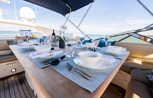 dining table on superyacht chess, with close up shot of place setting