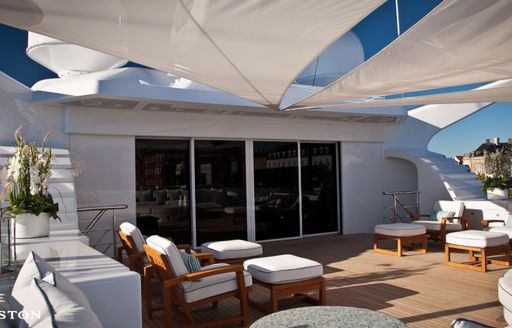 Sun deck with comfortable seats and sun awnings on superyacht Odessa II