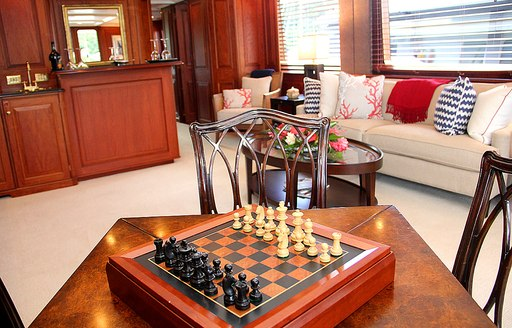 the interior games room with prepared chess set inside luxury superyacht Lady J