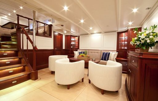 lounge area in bright and airy lower salon on board luxury yacht ANNAGINE