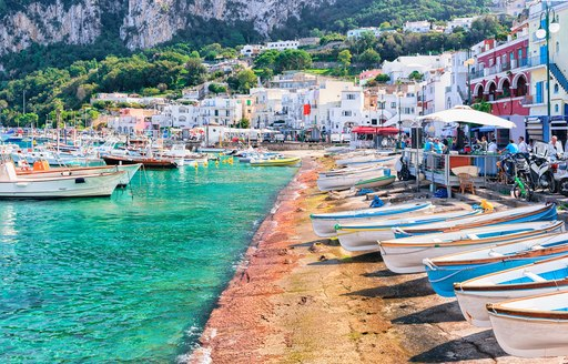 boats on the water at the marina in capri