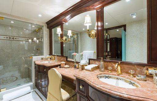 marble en-suite bathroom in the master suite of luxury yacht STARSHIP