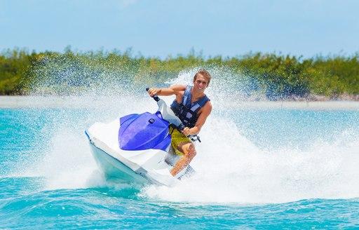 A man riding on a jetski