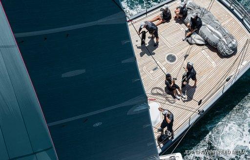 sailors on deck at nz millennium cup