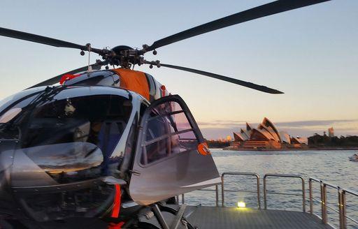luxury yacht tango helicopter on helipad during charter