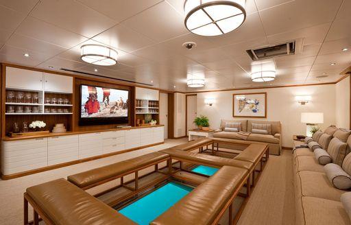 Glass floor in media room on board superyacht Suri