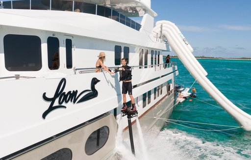 Man talking to woman on superyacht ZEAL