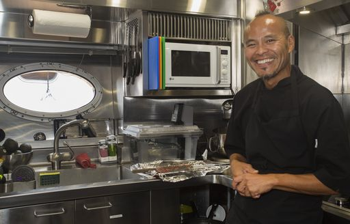 Chef Jean-Marc Masson in galley aboard superyacht BW at the 2017 Newport Charter Show